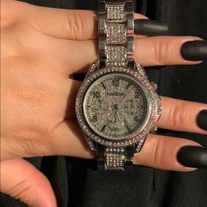 All over diamond stud watch